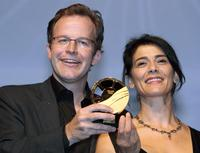 Director Tom Mc Carthy and Hiam Abbass at the award ceremony during the 34th US Film Festival.