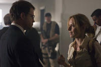Defense intelligence agent Clark Poundstone (Greg Kinnear) is questioned by journalist Lawrie Dayne (Amy Ryan) in