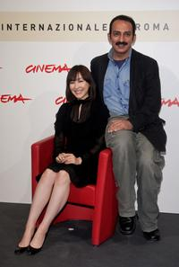 Kumiko Aso and Director Abolfazl Jalili at the photocall of