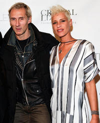 Photographer Martin Klinko and Eve Salvail at the Thuy New York Fall 2010 show during the Mercedes-Benz Fashion Week.