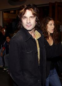Tommy Lee and Guest at the NBC 2005 Television Critics Winter Press Tour party.