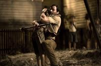 Hugh Jackman as The Drover and Brandon Walters as Nullah in