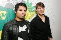 Michael Pena and Tom Cruise at the MTV's Total Request Live.