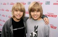 Cole Sprouse and Dylan Sprouse at the Bruce Willis Foundation Presents PlayStation BANDtogether.