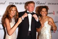Melania Knauss, Donald Trump and Lucia Rijker at the 13th Annual Elton John Aids Foundation Academy Awards Viewing Party.