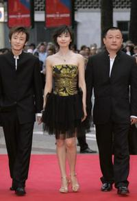 Li Bin, Gao Yuan Yuan and Wang Xiaoshuai at the 58th International Cannes Film Festival.