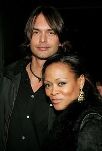 Robin Givens and Marcus Schenkenberg at the premiere of