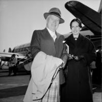 Charlie Chaplin and his wife Oona arrive at Paris Orly Airport.