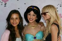 Kidada Jones, an actress posing as Jasmine and Nicole Richie at the Kidada Jones Disney Couture party.