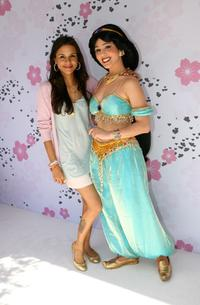 Kidada Jones and an actress posing as Jasmine at the Kidada Jones Disney Couture party.