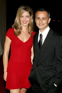 Christina Moore and Guest at the 2005 Macy's Passport Gala.