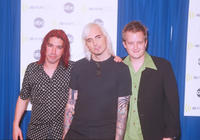Bassist Craig Montoya, Art Alexakis and Drummer Greg Eklund at the 2000 Radio Music Awards in Las Vegas.