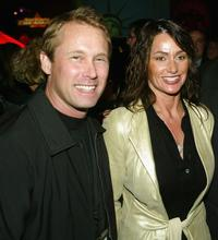 Bart Connor and Nadia Comaneci at the after party of the premiere of