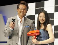 Atsuya Furuta and Yukie Nakama at the press preview of new Panasonic brand's Lamdash shaver and nano-care hair dryer.