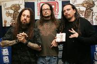 Fieldy, Jonathan Davis and James 'Munky' Shaffer at the autograph signing at J&R Music and Computer World.