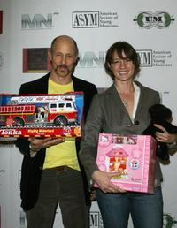 Jonathan Gries and Guest at the Holiday Toy Drive Fundraising Extravaganza.