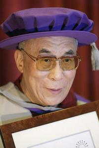 The Dalai Lama (XIV) at the ceremony to receive doctorate from the London Metropolitan University in central London.