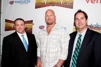 Christopher Bell, Stone Cold Steve Austin and producer Jim Czarnecki at the premiere of