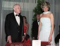 Alec Guinness and Princess Diana at a gala dinner at the 40th Cannes film festival.