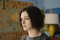 Anne Hathaway as Kym in