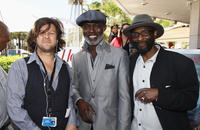 Limelight International Media Entertainment's Patrick Creamer, Eriq Ebouaney and Guest at the Hollywood Reporter cocktail party during the 64th Annual Cannes Film Festival in France.
