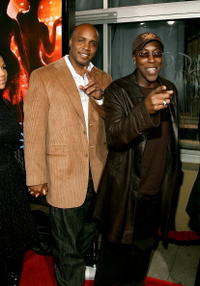 Arsenio Hall and Barry Bonds at the premiere of
