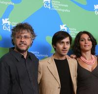 Director Andrea Porporati, Luigi Lo Cascio and Donatella Finocchiaro at the photocall of