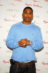 Nelly at the d.e.m.o. clothing store to promote Apple Bottoms clothing line.