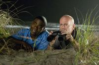 Tracy Morgan as Paul and Bruce Willis as Jimmy in
