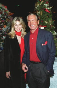 George Hamilton and Alana Stewart pose for a picture during