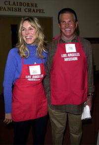 George Hamilton and Alana Stewart at the Los Angeles Mission during