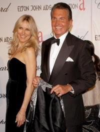 George Hamilton and Alana Stewart at the 13th Annual Elton John Aids Foundation Academy Awards Viewing Party.