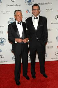 George Hamilton and Guest at the 30th anniversary Carousel of Hope Ball.