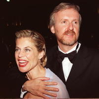 Linda Hamilton and James Cameron celebrates at the Titanic party.