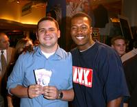 Flex Alexander congratulates winner of NBA tickets at the Celebrity Panel discussion at 2003 NBA Playoffs.