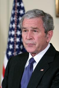 George W. Bush at the Billion Auto Industry Bailout Plan.