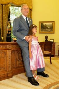 President George W. Bush and Catharine Aboulhouda at the Oval Office of the White House.