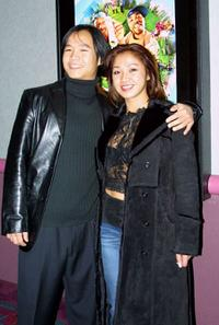 Trieu Tran and Guest at the premiere of