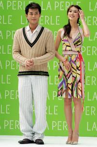 Louis Koo and Chiling Lin at the La Perle Spring and Summer Series Fashion Show.