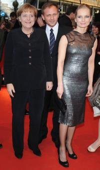 Angela Merkel, Andrzej Chyra and Magdalena Cielecka at the premiere of