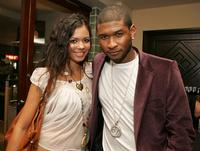 Jennifer Freeman and Usher at the launch party for Usher's