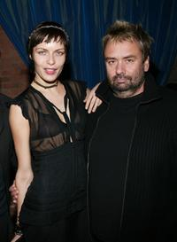 Rie Rasmussen and Director Luc Besson at the launch party of the new photo book
