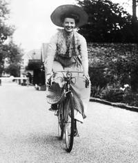 Katharine Hepburn riding a bicycle between scenes of the classic American movie