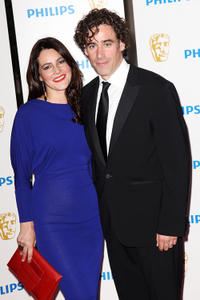 Stephen Mangan and Guest at the Phillips British Academy Awards 2011 in London.