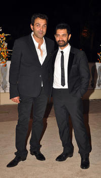 Bobby Deol and Aamir Khan at the wedding reception of Imran Khan and Avantika Malik in Mumbai.