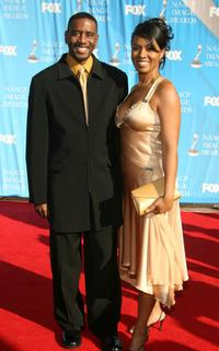 Reggie Gaskins and Guest at the 38th Annual NAACP Image Awards.