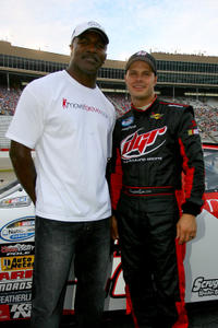 Evander Holyfield and driver David Gilliland at the NASCAR Nationwide Series Degree V12 300 in Georgia.