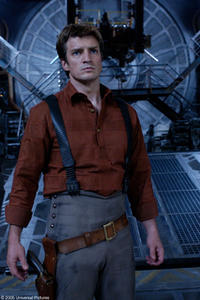 Nathan Fillion as Captain Malcolm Reynolds ponders his next move on an alien craft.