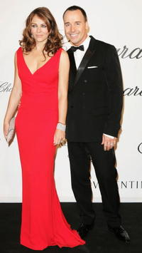 Elizabeth Hurley and David Furnish at the Chopard and Valentino Party Dinner during the 60th International Cannes Film Festival.