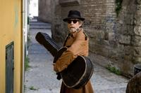 John Hurt as Guitar in